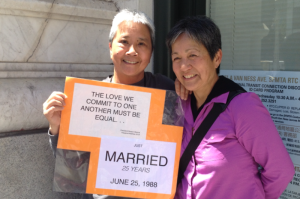 After 25 years, Trinity and Desiree are finally able to get married. They carried this sign around to tell their story and explain their happiness. Photo: Alexandra Hsieh and Gautami Sharma